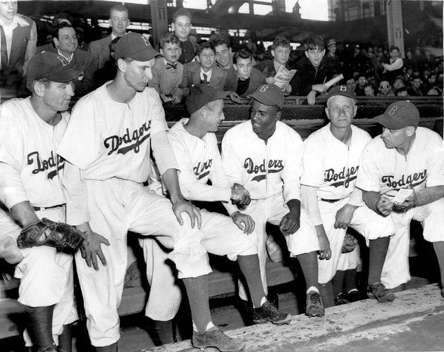"Per The New York Times: ""The trailblazer Jackie Robinson in an Ebbets Field dugout in 1947 with members of the Brooklyn Dodgers."" For some reason they left out Eddie (C) 2013 The New York Times"