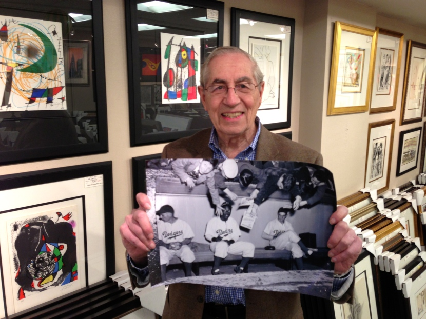"Eddie Dweck holds a copy ""the photograph"" at Studio 57 Fine Arts Gallery, March 2013"